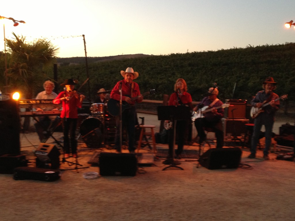 Monty Mills and his band in front of the Cass vineyard.